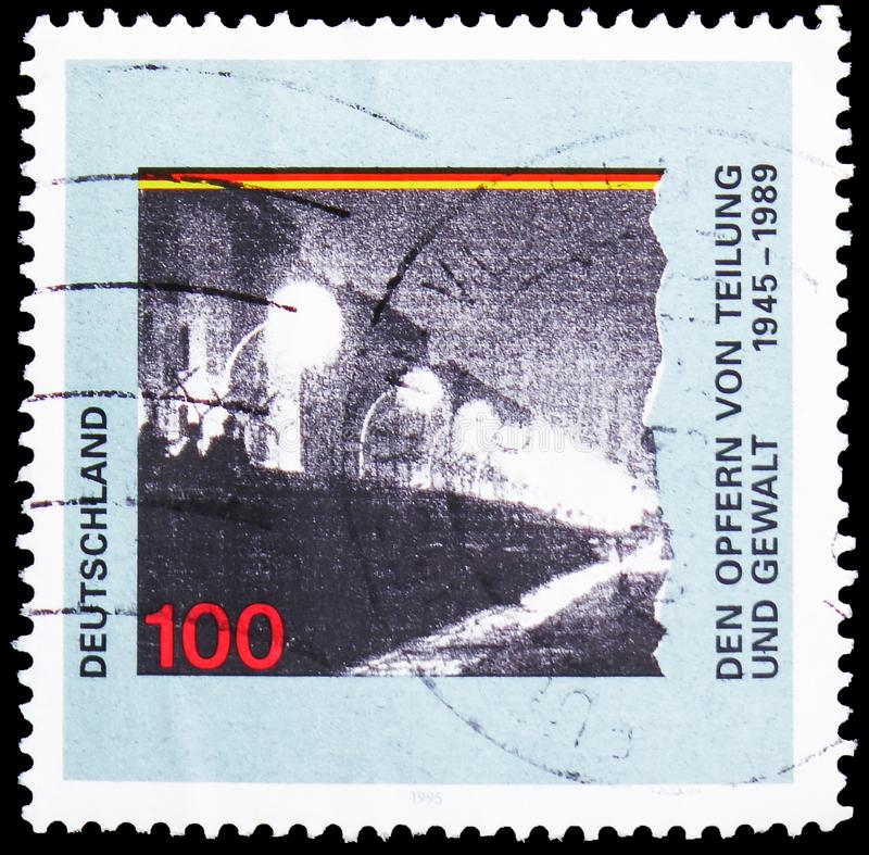 The victims of division and violence Berlin wall, Commemorating Victims of Political Oppression serie, circa 1995. MOSCOW, RUSSIA - MAY 25, 2019: Postage stamp royalty free stock image