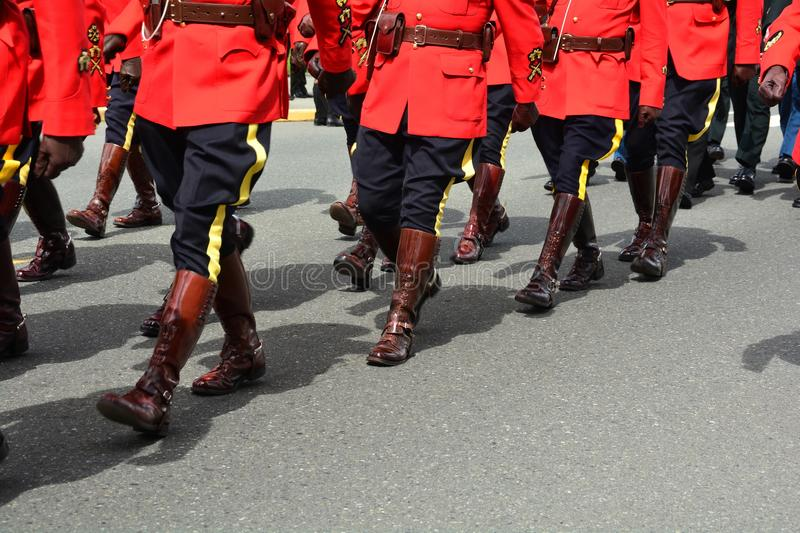 RCMP officers march in unison. Victoria BC,Canada,April 19th 2018.RCMP police officers in their red tunics march to the church for a funeral for a fallen officer stock images