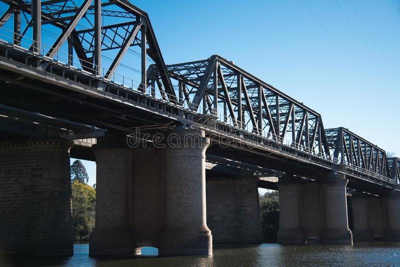 The Victoria Bridge, over Nepean River and officially known as The Nepean Bridge, is a heritage-listed former railway bridge. The Victoria Bridge, over Nepean royalty free stock photo