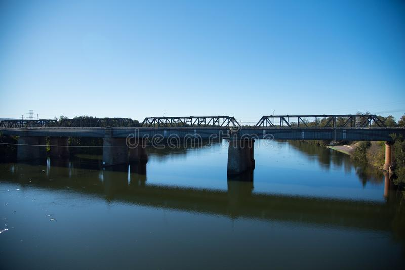 The Victoria Bridge, over Nepean River and officially known as The Nepean Bridge, is a heritage-listed former railway bridge. The Victoria Bridge, over Nepean stock photography