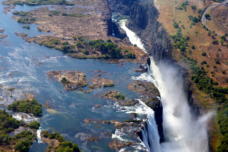 Victoria Falls air view. The Victoria Falls or Mosi-oa-Tunya (the Smoke that Thunders) is a waterfall located in southern Africa on the Zambezi River between stock photos