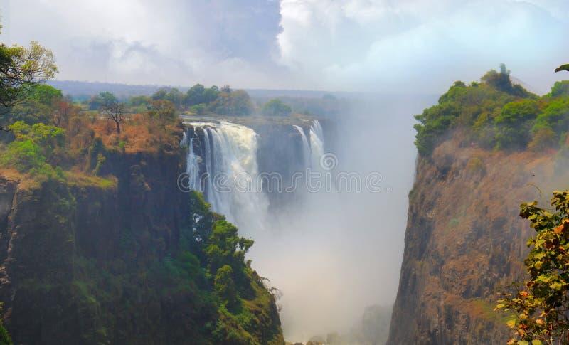 Victoria Falls icónica y x28; y x28; Mosi-en-tunya& x29; Llandscape tomado del lado de Zimbabwe, África fotos de archivo libres de regalías