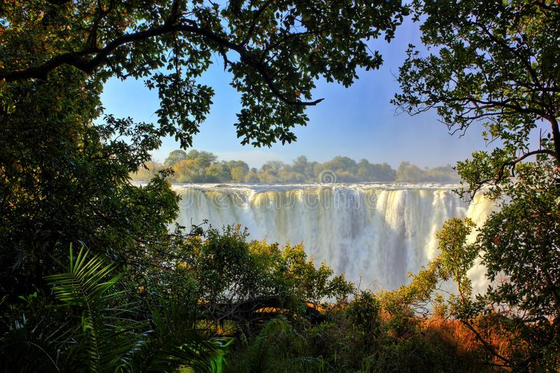 Victoria Falls, waterfall in southern Africa on the Zambezi River at the border between Zambia and Zimbabwe. Landscape in Africa. stock photography