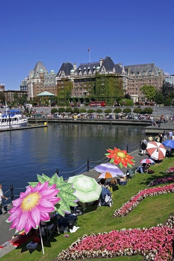 Victoria Harbor e hotel famoso da imperatriz fotografia de stock