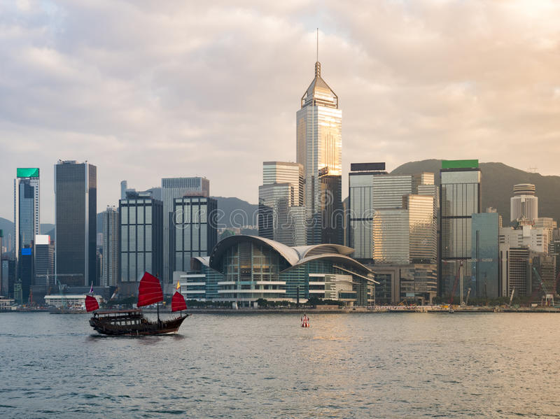 Victoria harbor : Hong Kong. Hong Kong Victoria harbor with tourist junk in the morning stock images