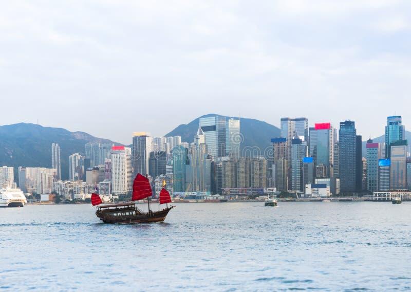 Victoria harbor : Hong Kong. Hong Kong Victoria harbor with tourist junk in the morning stock photography