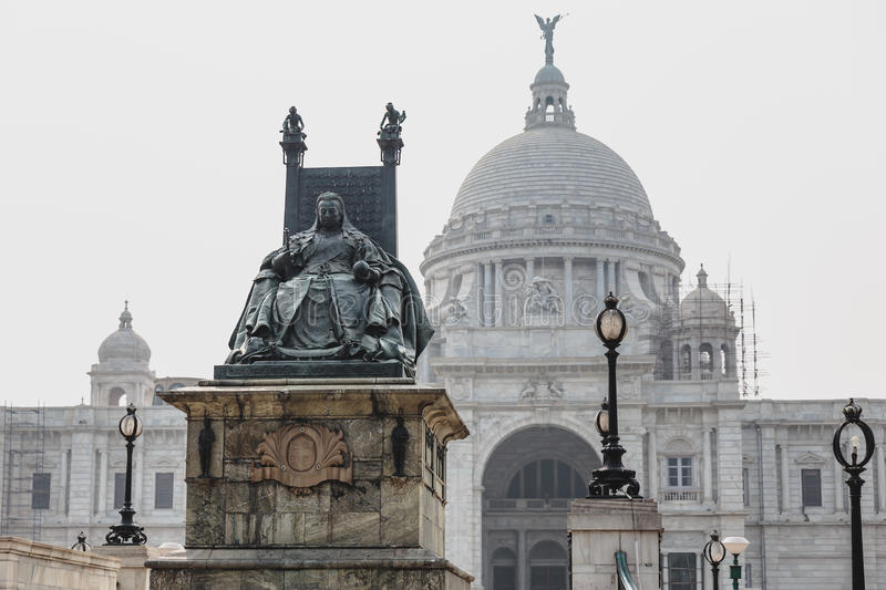 VIctoria Memorial Hall in Kolkata, India.Queen Victoria statue with throne in front of VIctoria Memorial Hall in Kolkata, India. stock photo