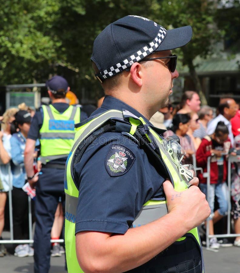 Victoria Police Constable fornece a segurança durante a parada 2019 do dia de Austrália em Melbourne foto de stock