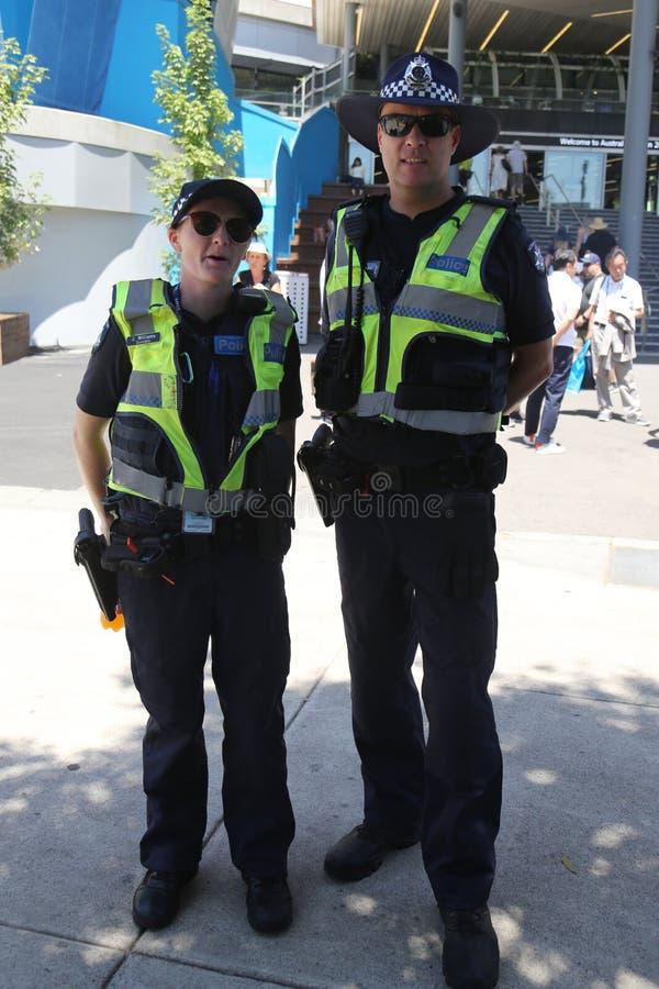 Victoria Police Constable que fornece a segurança no parque olímpico em Melbourne durante 2019 australianos abre foto de stock royalty free