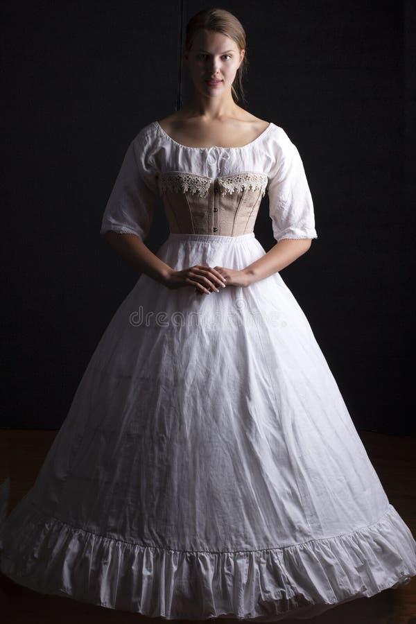 Victoriaanse vrouw in ondergoed stock afbeeldingen