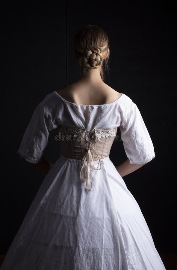 Victoriaanse vrouw in ondergoed stock foto