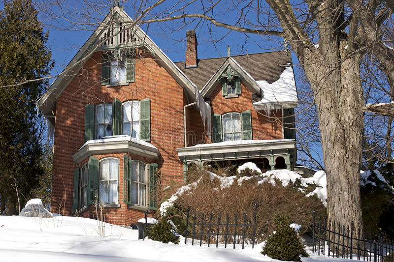 Victorian Architecture. Canadian winter scene with an original heritage Victorian home built in the 1800's. Set in the town of Port Hope, Ontario stock photos