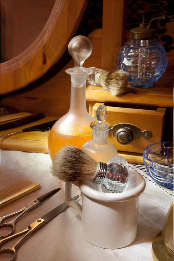Victorian barbershop. With antique tools and bottles stock images