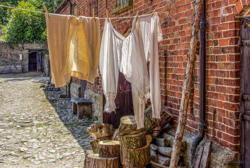 Victorian Bloomers And Long Johns. A view of Victorian Bloomers and Long Johns hanging out to dry in a back yard stock images