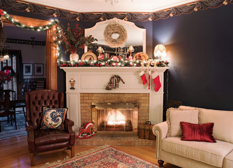 Victorian Christmas Fireplace Corner. Christmas decor with fireplace in old Victorian living room with copy space on wall stock images