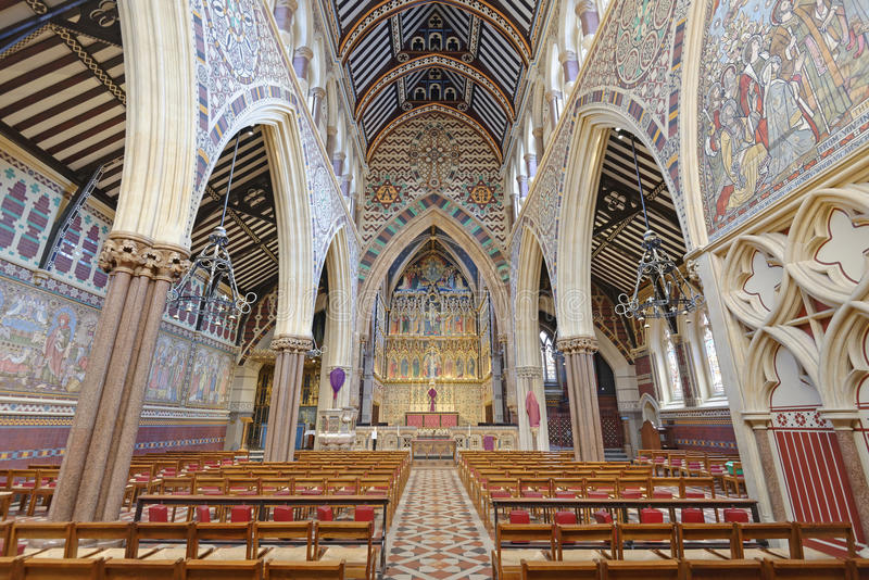 london, england: all saints Victorian church spectacular gothic interior stock photography
