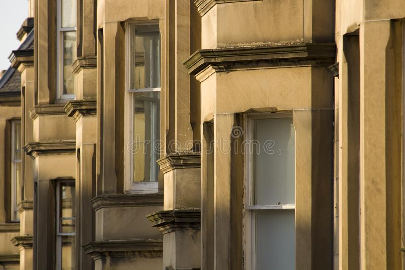 Victorian colony homes made of sandstone in Edinburgh, Scotland. Picture at Comely Bank Ave. Comely Bank is an area of Edinburgh, the capital of Scotland. It stock photos