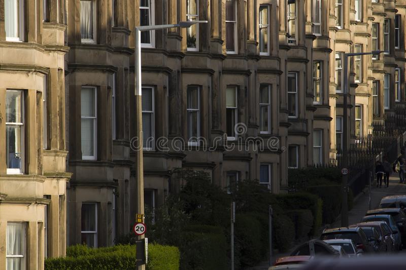 Victorian colony homes made of sandstone in Edinburgh, Scotland. Picture at Comely Bank Ave. Comely Bank which is an area of Edinburgh, the capital of Scotland royalty free stock image