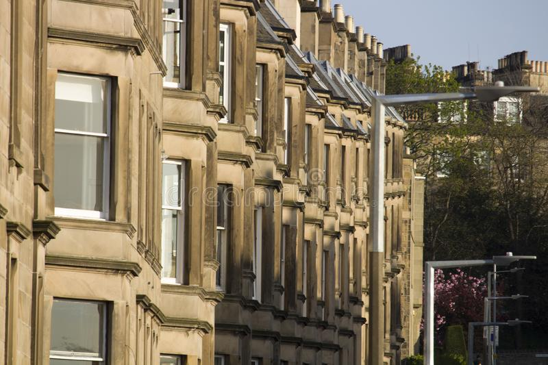 Victorian colony homes made of sandstone in Edinburgh, Scotland. Picture at Comely Bank Ave. Comely Bank which is an area of Edinburgh, the capital of Scotland royalty free stock images