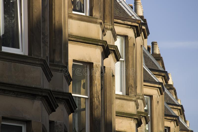 Victorian colony homes made of sandstone in Edinburgh, Scotland. Picture at Comely Bank Ave. Comely Bank which is an area of Edinburgh, the capital of Scotland royalty free stock photos