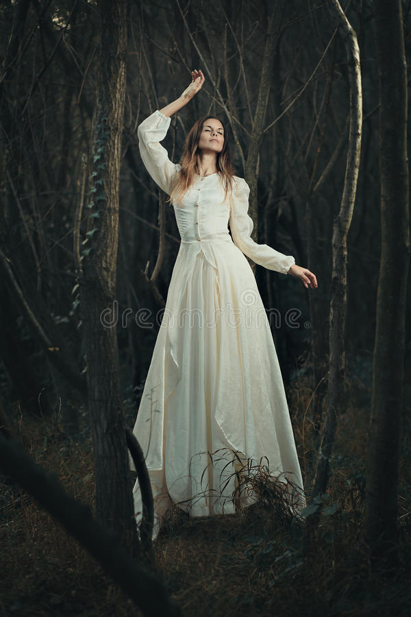 Victorian dressed woman levitation. Surreal and ethereal stock photography