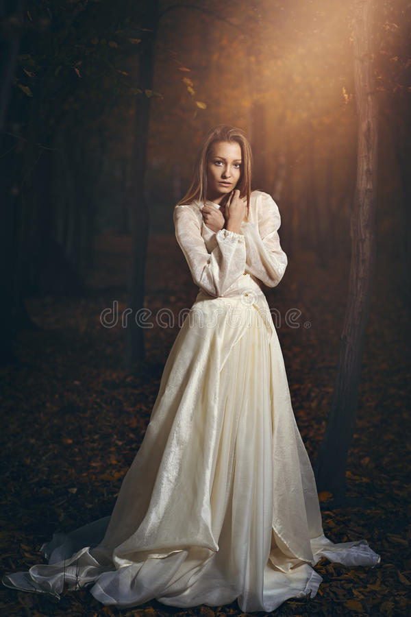 Victorian dressed woman in magical forest. Romantic and fantasy stock images