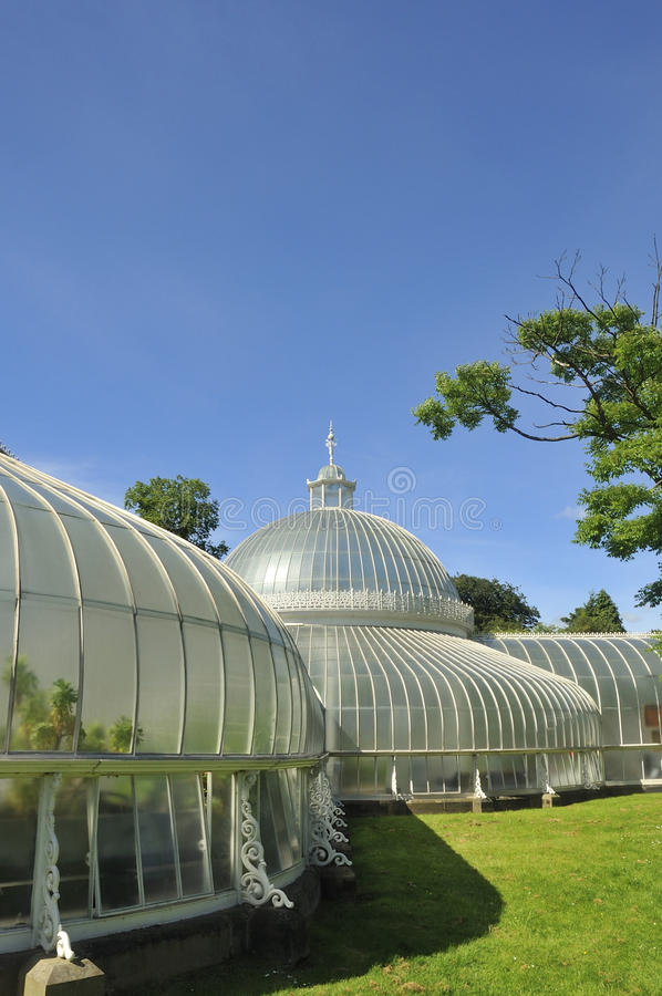 Victorian glasshouse. Portrait view of the restored Victorian wrought iron framed glasshouse known as Kibble Palace, Glasgow Botanic Gardens, Scotland royalty free stock images
