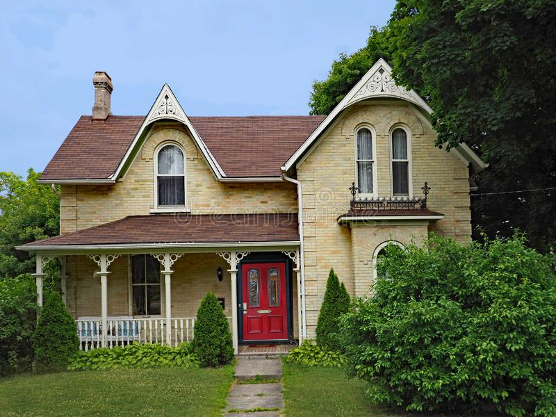 Victorian Gothic style farm house. With full width porch stock photography