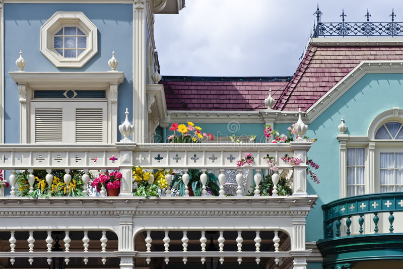 Victorian Homes. Colorful Victorian homes with Spring flowers royalty free stock image