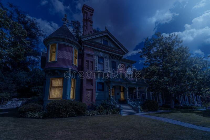Victorian house by moon light royalty free stock photo