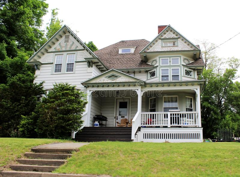 Victorian house in upstate Franklin County, New York, United States. Two story white Victorian house located in upstate Franklin County, New York, in the United royalty free stock photos