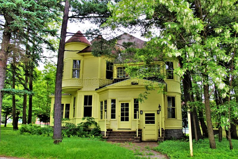 Victorian house in upstate Franklin County, New York, United States. Two story yellow Victorian house located in upstate Franklin County, New York, in the United royalty free stock images