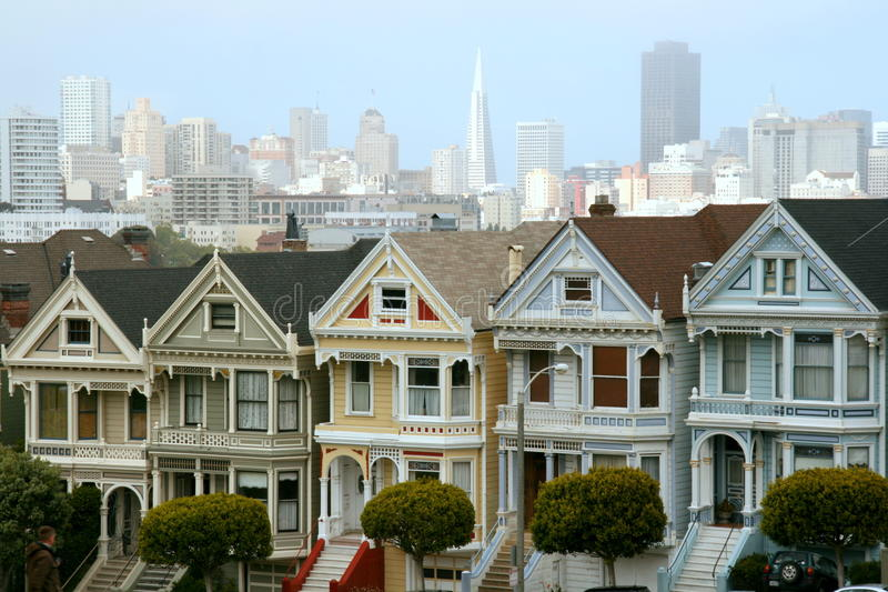 Victorian houses. Old victorian houses with the city of San Francisco as a backdrop royalty free stock photos