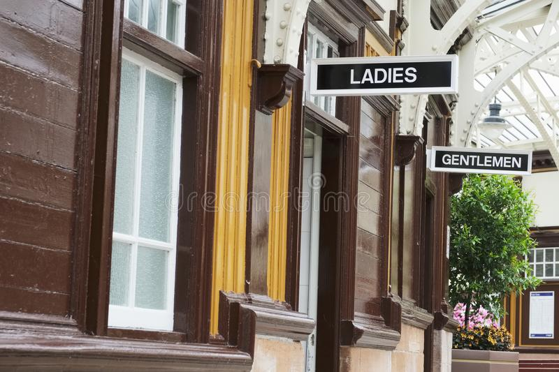 Victorian ladies and gents toilets Art Deco style white and black sign. Uk royalty free stock photos