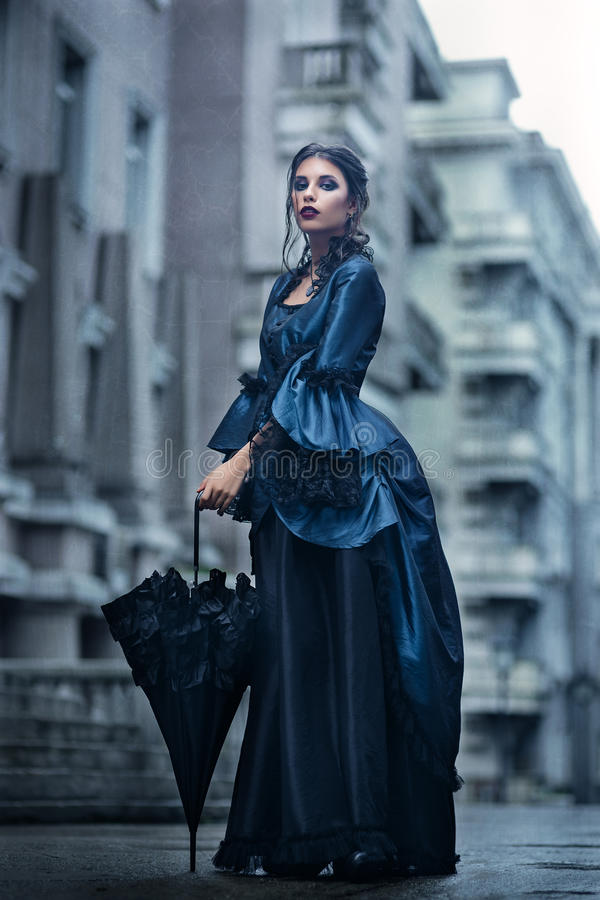 Victorian lady in blue royalty free stock images