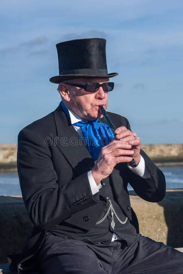 Free Victorian Man Playing Tin Whistle Stock Image - 66164551