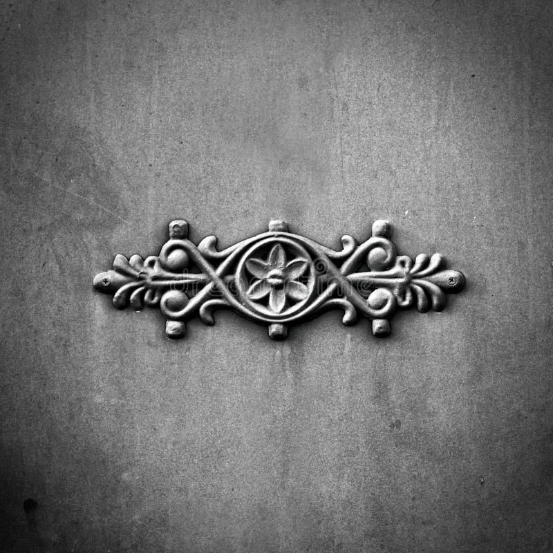 Victorian ornamental work of metal on antique steel gate. black and white image royalty free stock image