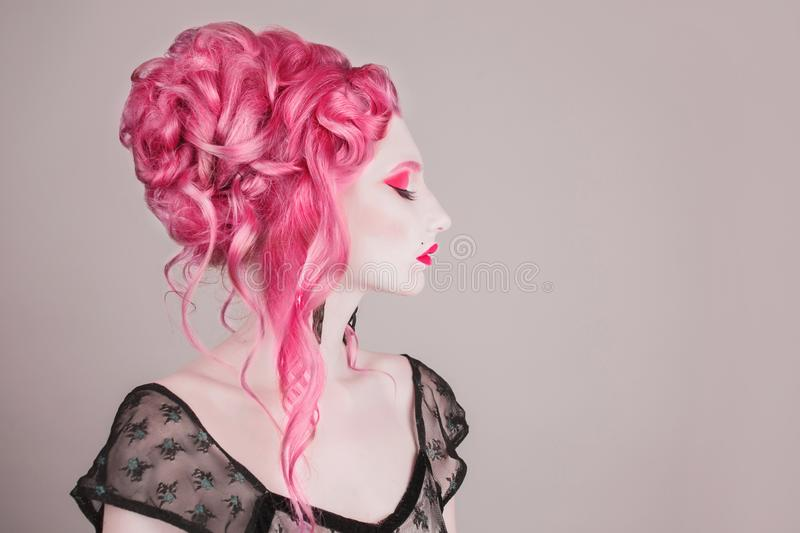 Victorian pink hair model. Expensive jewelry. Redhead woman with rococo hairstyle in victorian dress. Halloween gothic makeup. Renaissance model. High stock photography