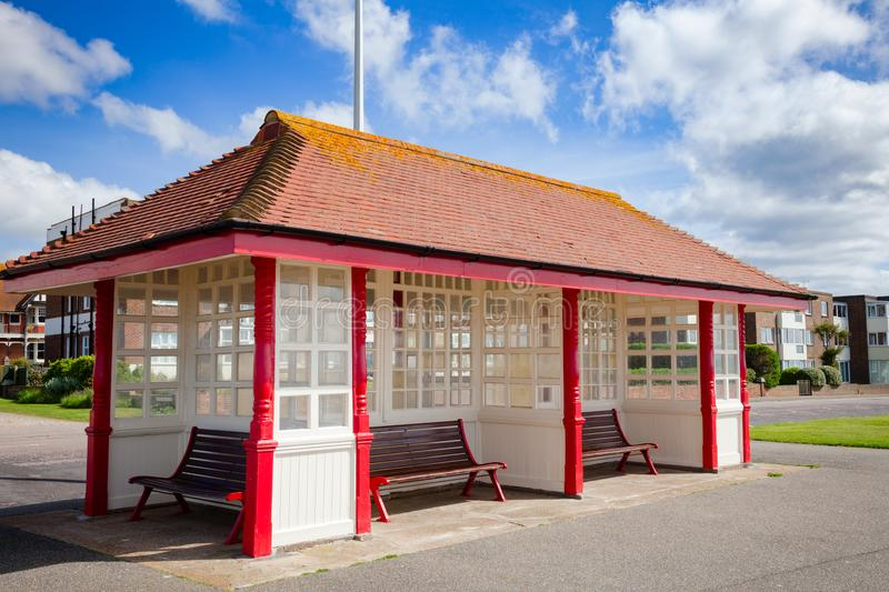 Victorian seafront shelter in Bexhill East Sussex South East Eng. Victorian wooden sea front shelter and seating at popular seaside resort Bexhill-on-Sea in East royalty free stock image