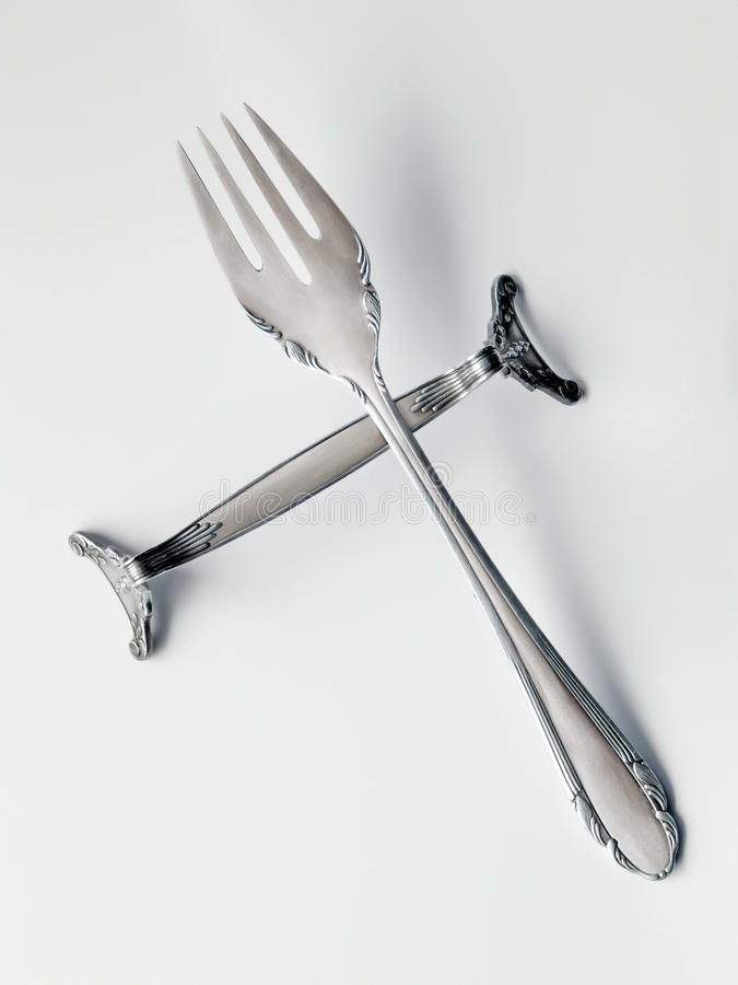Victorian silver fork on silver knife rest royalty free stock image