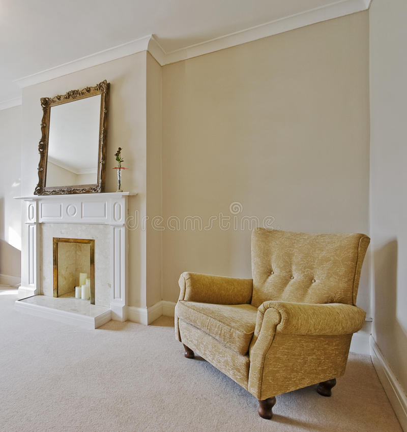 Victorian style living room. With a vintage armchair and fireplace royalty free stock photos