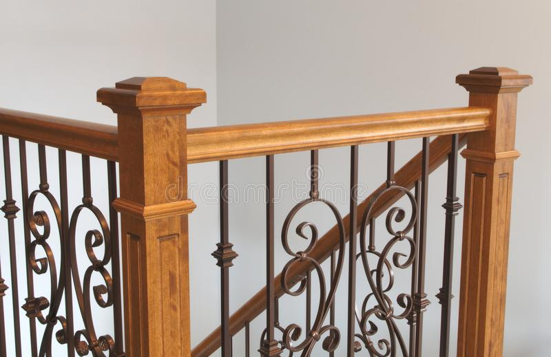 Victorian style staircase wood newel post haindrail brown metal baluster close-up. Wood stairs newel handrail staircase home interior classic victorian style royalty free stock photo