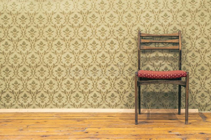 Victorian style vintage pattern wallpaper. Ornamental background and chair stock image