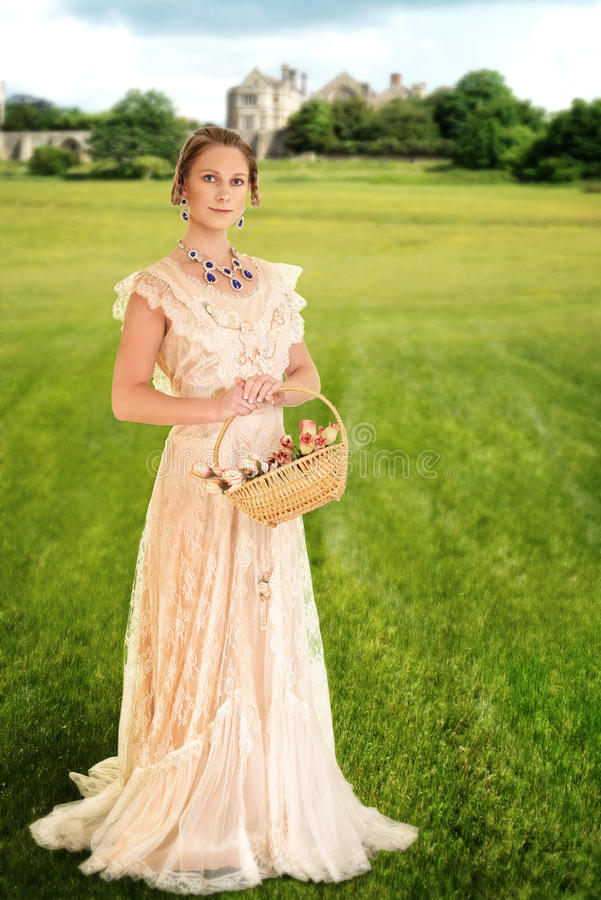 Victorian woman with basket of roses royalty free stock photography