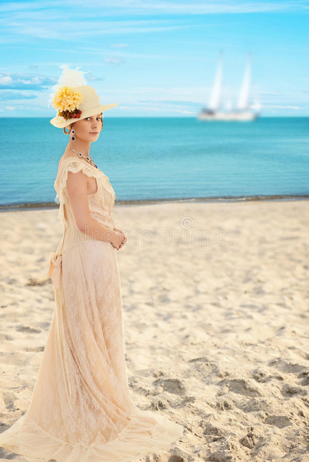 Victorian woman at the beach. Portrait of victorian woman at the beach stock image
