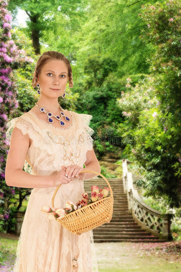 Victorian woman in garden with roses. Portrait of victorian woman in garden with roses royalty free stock images