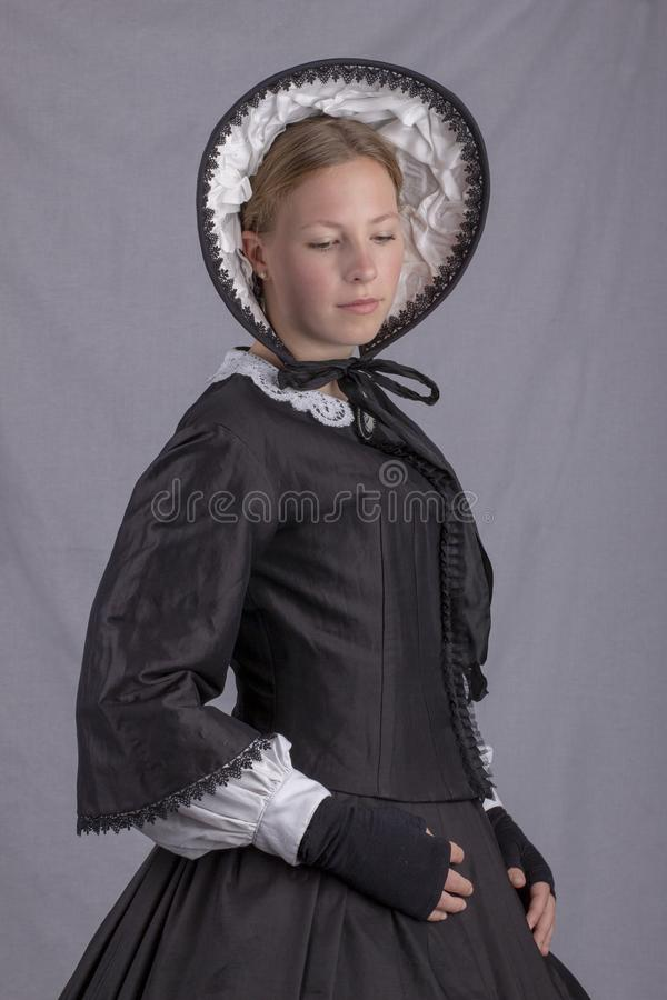 Free Victorian Woman In A Black Bodice And Bonnet Royalty Free Stock Photography - 151671237