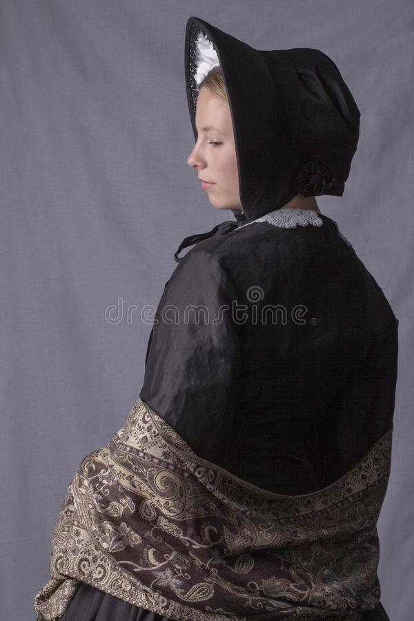 Free Victorian Woman In A Black Bodice, Shawl And Bonnet Stock Image - 151671801