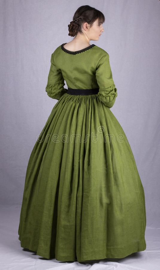 Free Victorian Woman In A Green Bodice And Skirt Royalty Free Stock Photo - 151460325