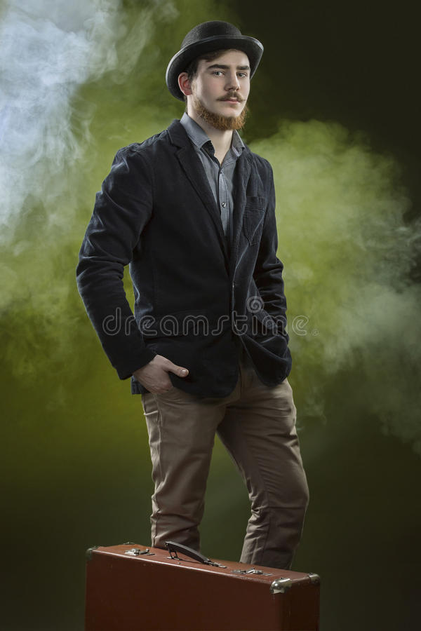 Victorian young man in bowler hat. Dark Background. royalty free stock photos
